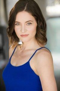 Sandra Frank, light skinned in blue dress with dirty blond hair