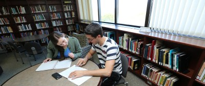 Two students study at a table in Resnick