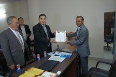 Prof Madan DLA receiving award from Mongolian Embassy
