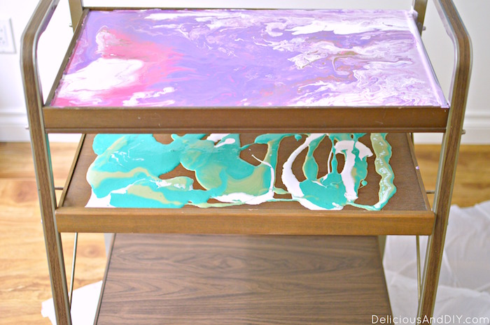 Give a stunning makeover to your old bar cart using drip pour technique, colored gem stones and resin to give it a gorgeous finish| Home Decor | Painted Furniture| Marbled Painted Furniture| Faux Marble| Dirty Pour| Drip Art Painting| Resin Art| Epoxy and Resin Furniture| High Gloss Furniture| Bar Cart Transformation| Recycled Furniture| Upcycled Furniture| Refinished Furniture