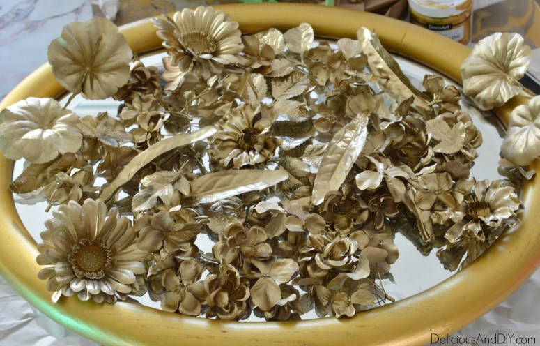 Create an Anthropologie Knock Off Mirror for less than $20 just by using Gold Spray Paint and Faux Flowers| Create a Stunning Anthro Inspired Gold Mirror all by using products which cost under $20| Anthropology Flower Gold Mirror
