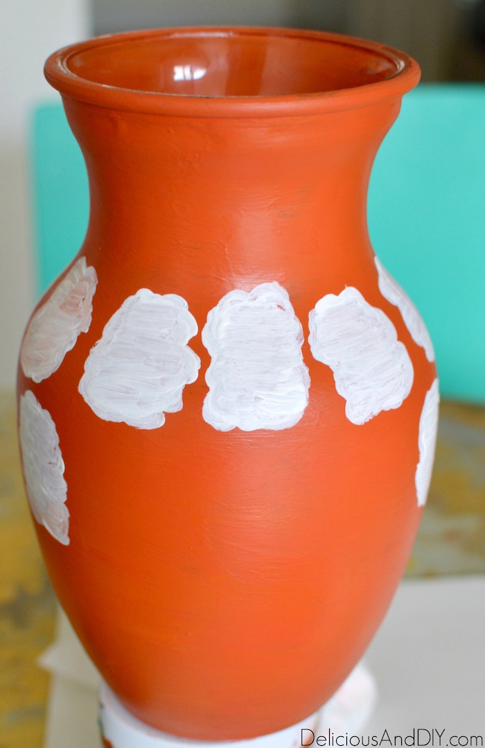 Painting a white cloud shaped pattern all around the Orange Painted Vase