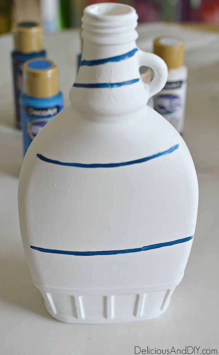 Start by painting lines onto the Anthropologie Inspired Vase to create your own for half the price