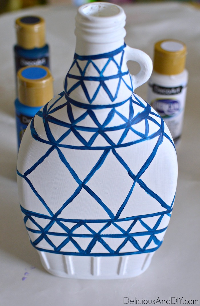 Paint the Vase using a Dark Blue paint to create lines and diamond like the original Anthropologie Inspired Vase