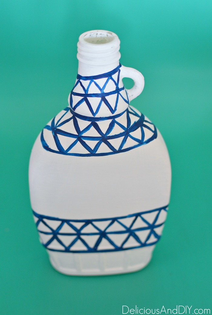 Use a dark blue paint to create the gorgeous pattern Inspired by an Anthropologie Vase
