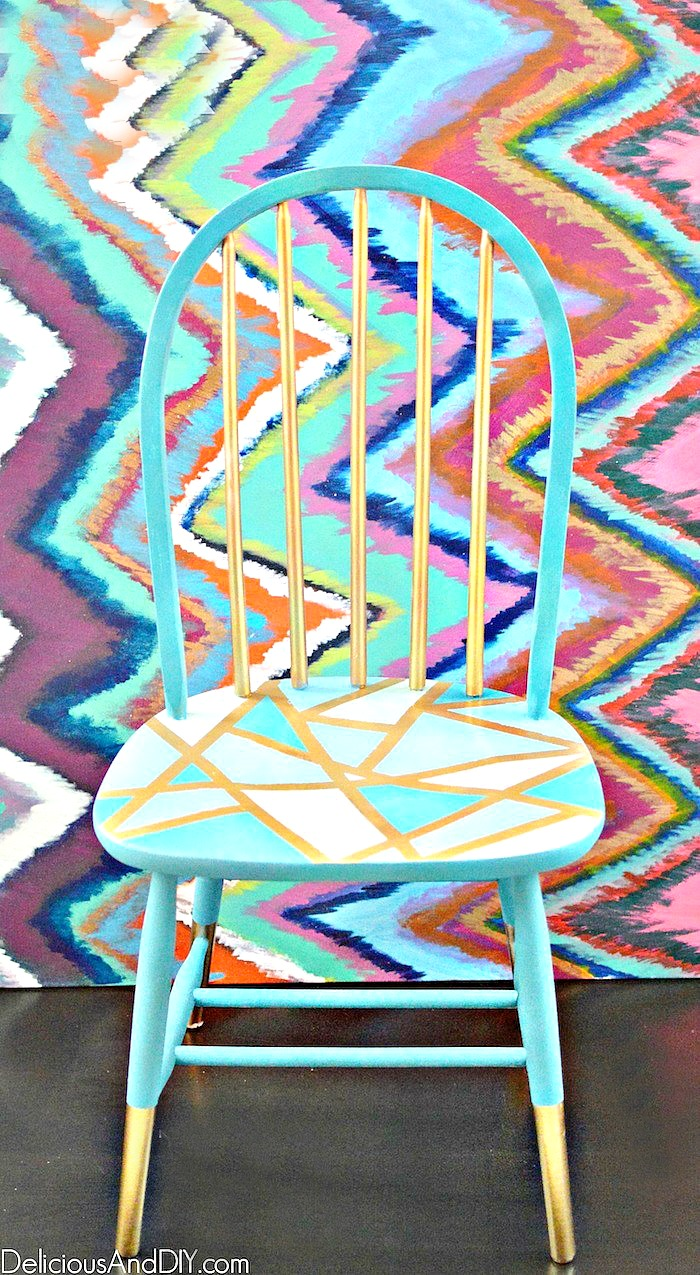 Final staged picture of painted wooden chair with gold dipped legs