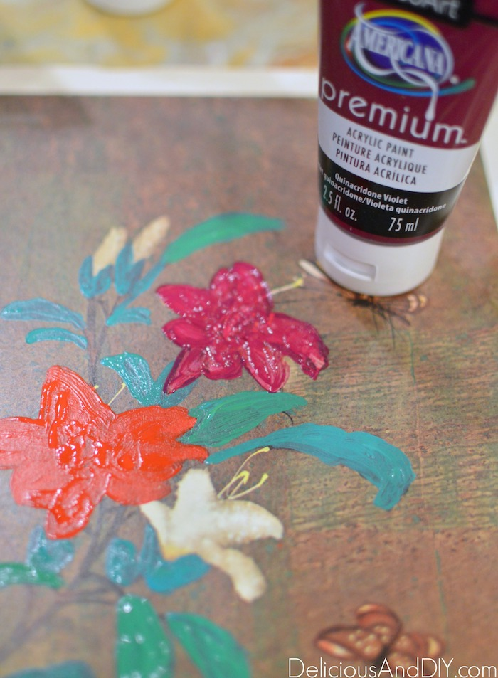 Painting over the thrift store art with multiple paint colors