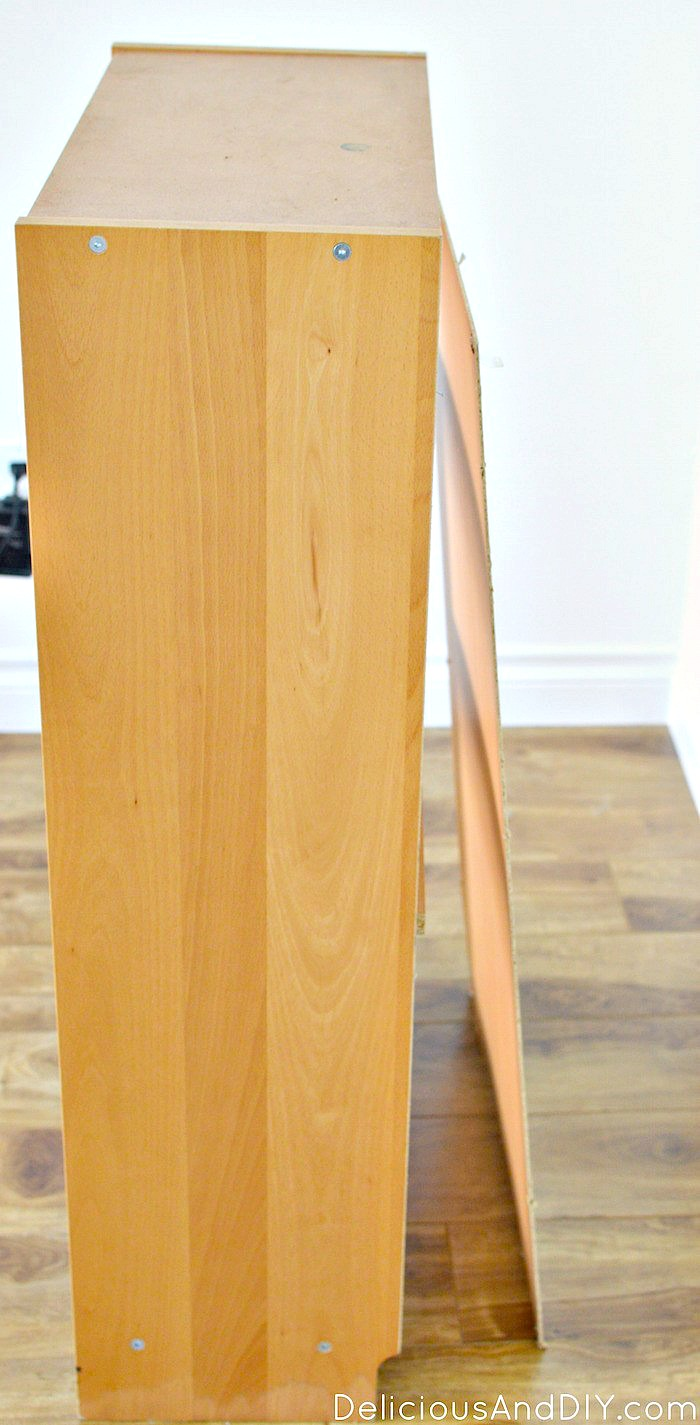 Side picture of a broken wooden bookshelf before its transformation