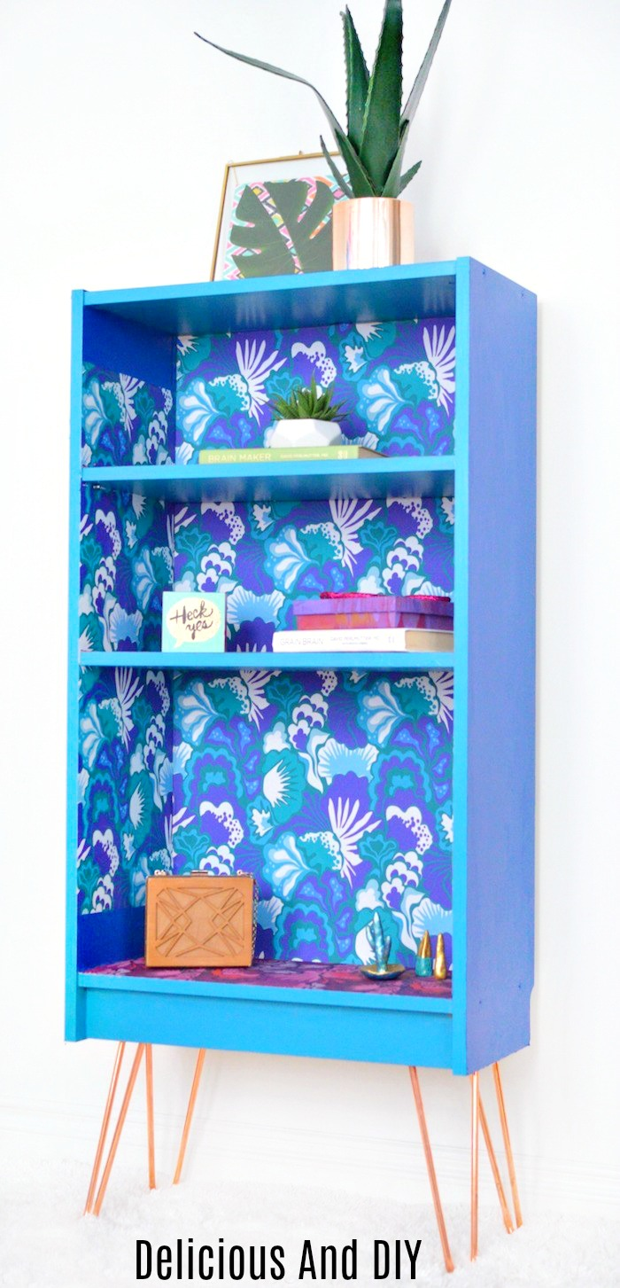 Finished look of a Bookshelf that was updated with Peel and Stick Wallpaper and Hairpin Legs