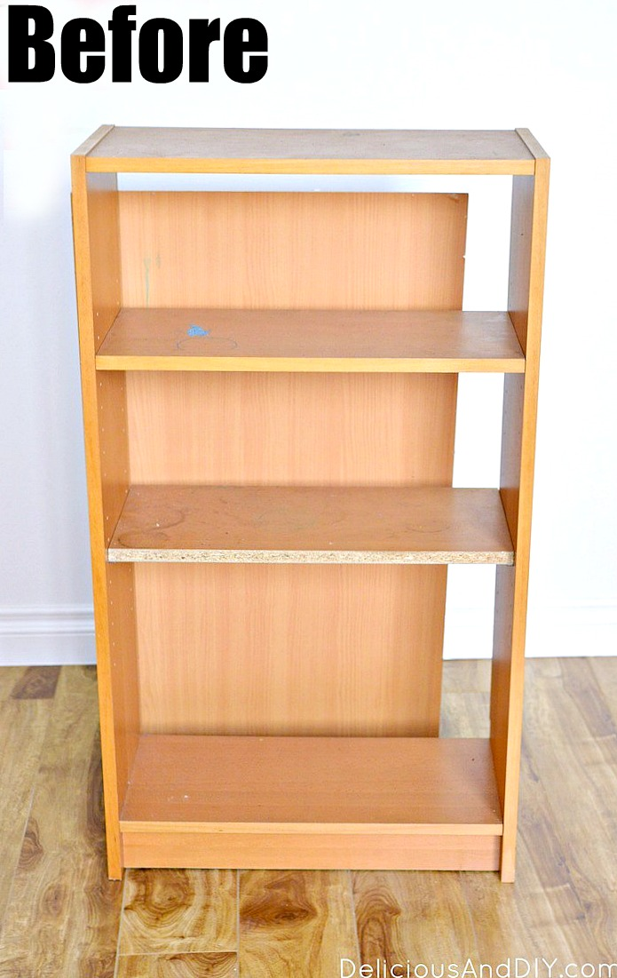 A before picture of thrifted bookshelf with the backside detached and scratches.
