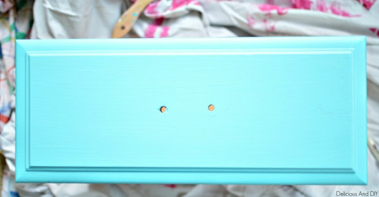A thrift store nightstand drawer painted blue