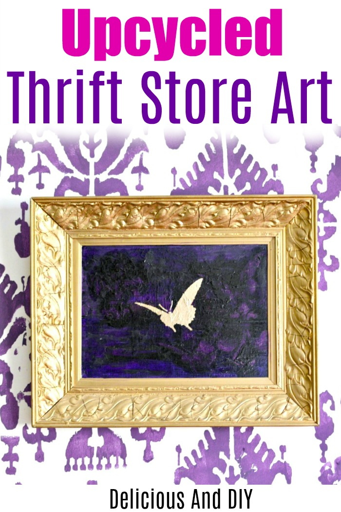 Upcycled thrift store art using purple paint and gold stenciling