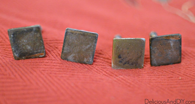 Rusted square drawer knobs before being painted