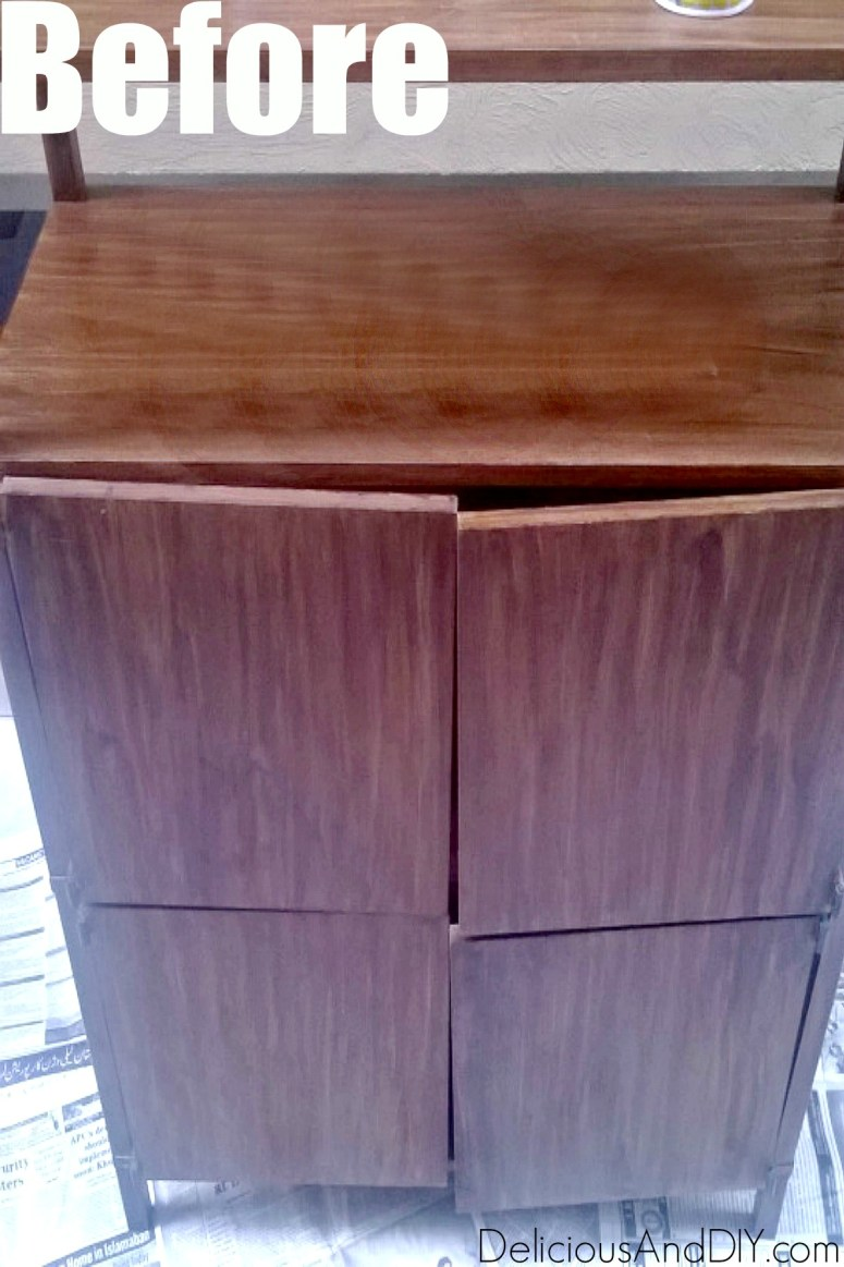 brown colored storage cabinet before being painted