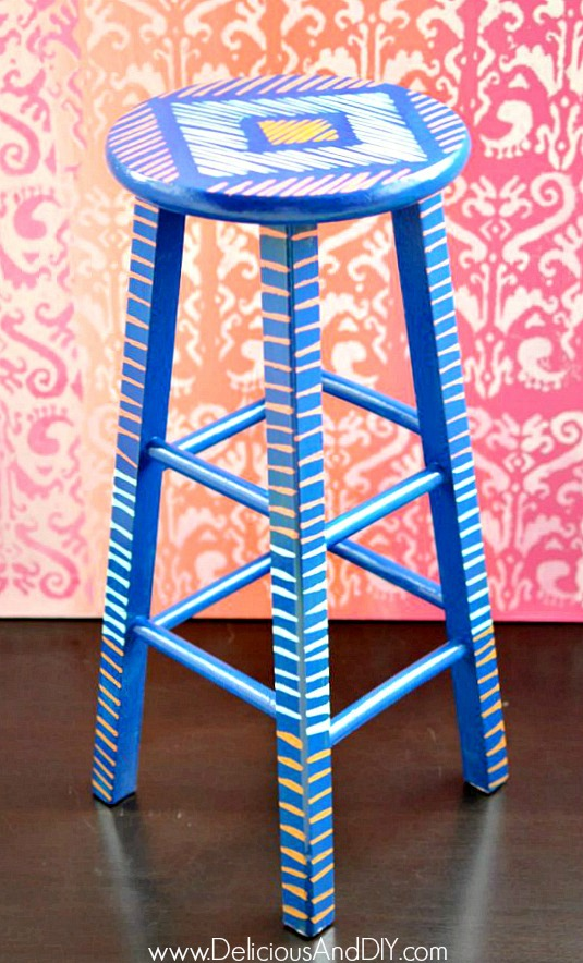 multicolored painted wooden bar stool