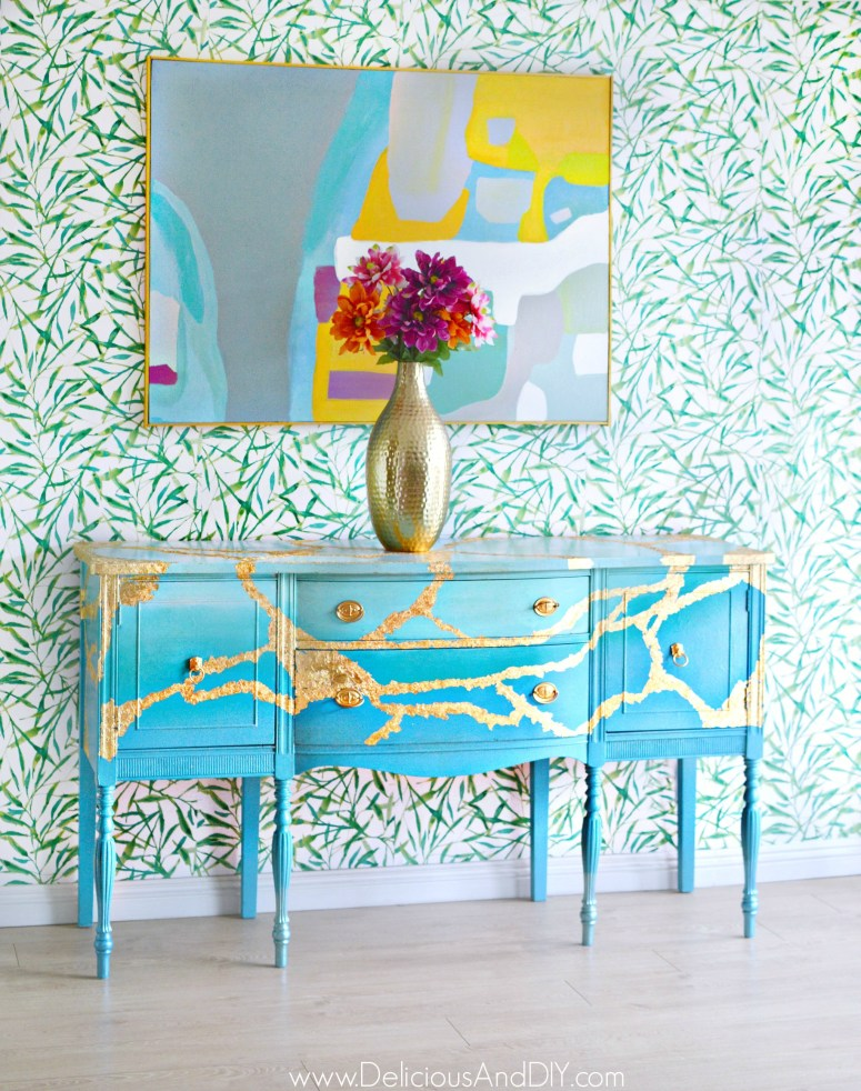 Gold leafed and blue painted buffet table
