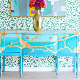 gold leafed and painted buffet table