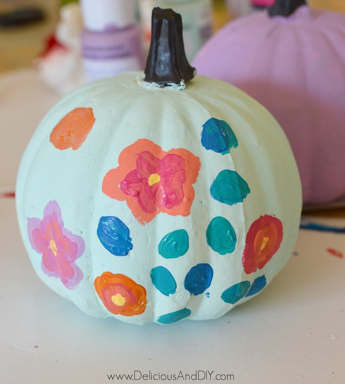 painting flowers onto dollar store pumpkin