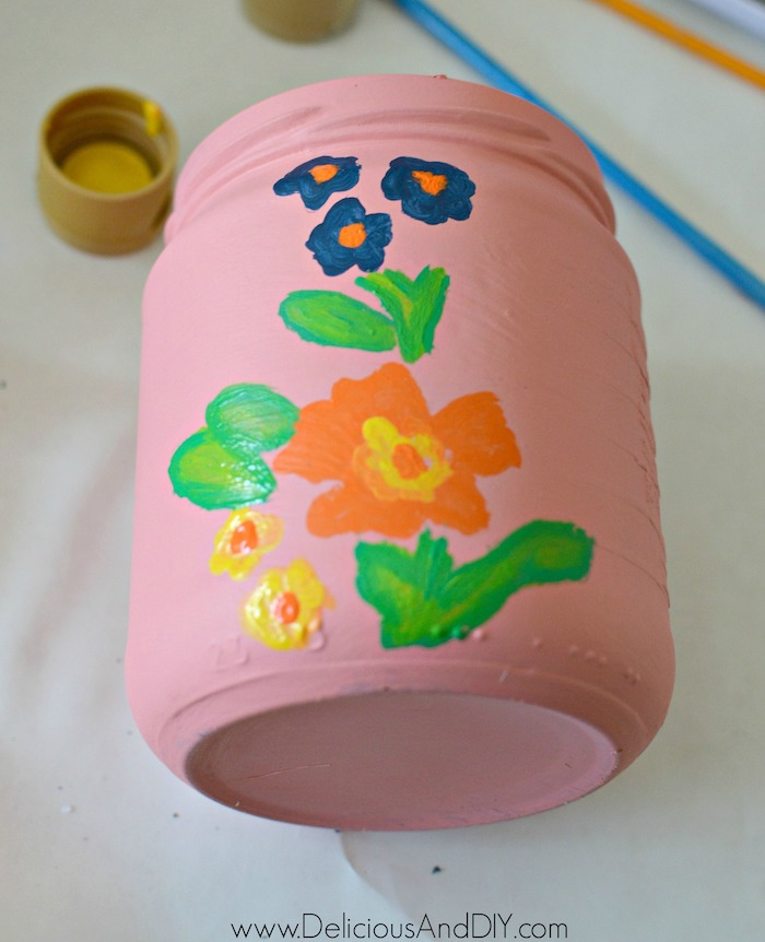 floral flowers being painted on the vase
