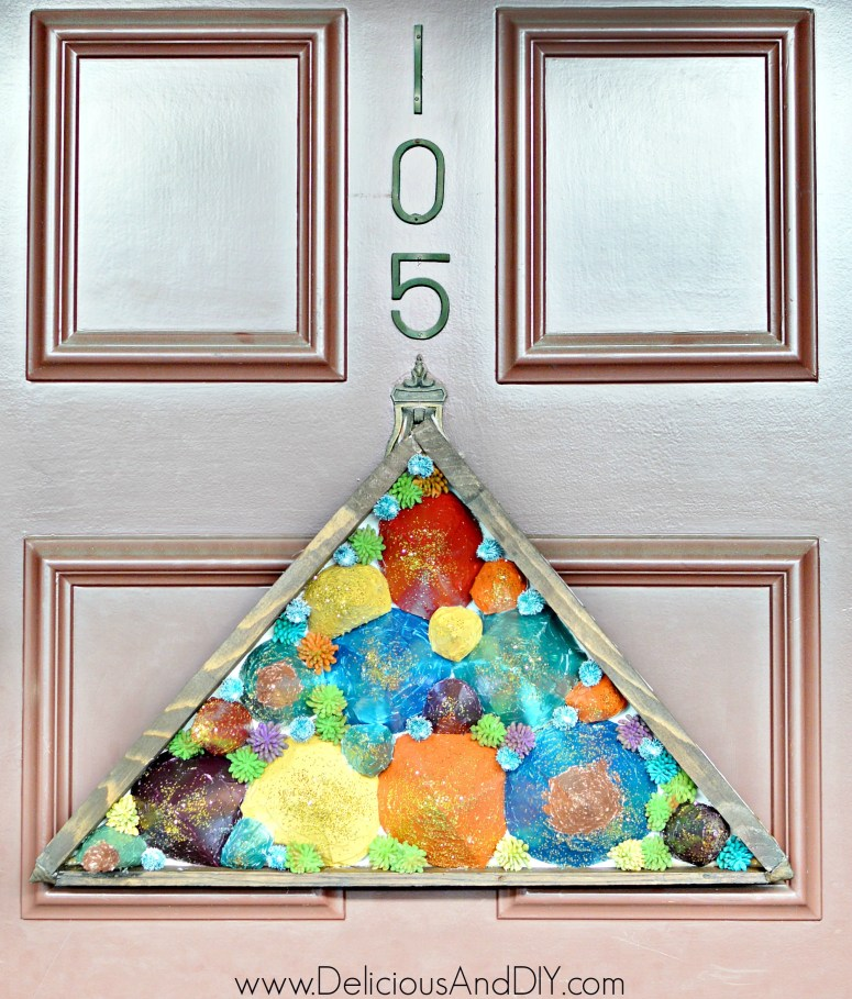door decor triangle shaped wreath made with paper cones