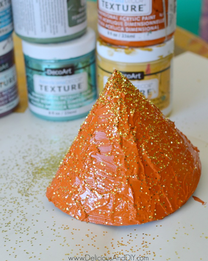 sprinkling glitter on paper cone