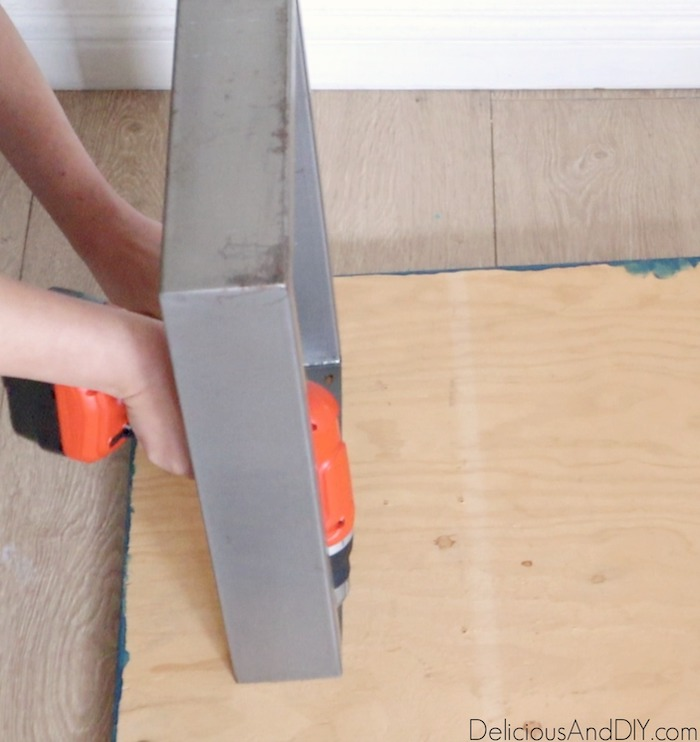 attaching square bench legs onto the wood