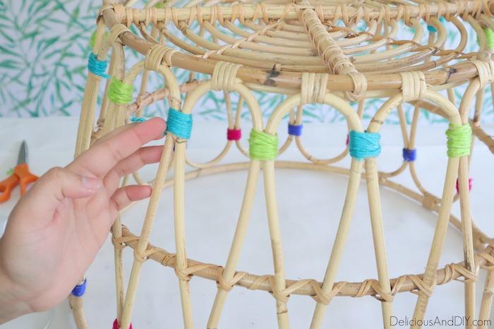 wrapping blue yarn around the ikea basket