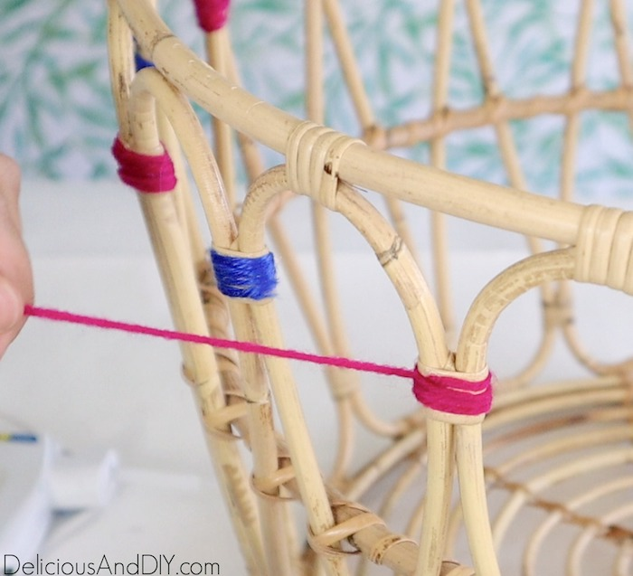 wrapping pink yarn around the ikea basket