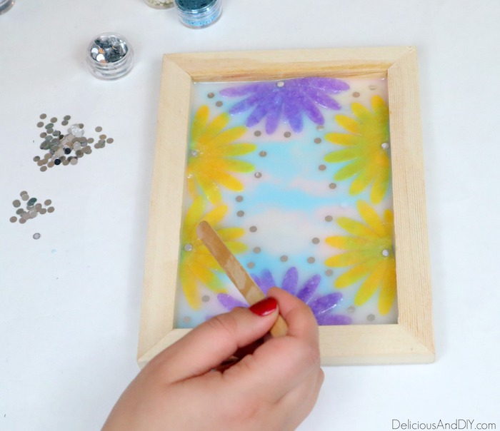 felt flowers being placed in the resin tray