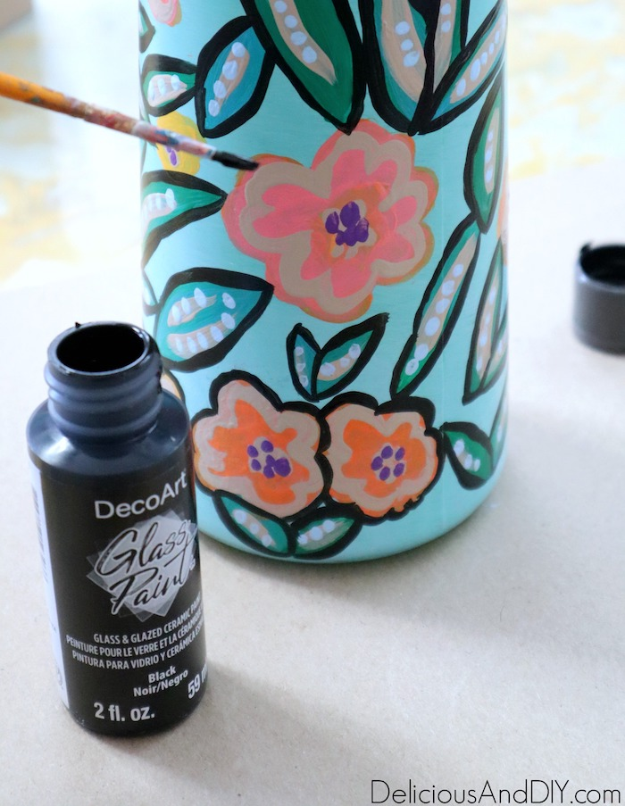 painting the borders of the flower with black glass paint