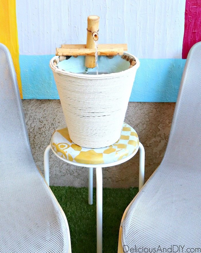 outdoor water fountain on an ikea stool
