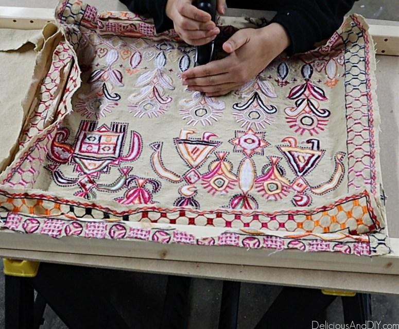 staple the fabric onto the ikea ivar cabinet