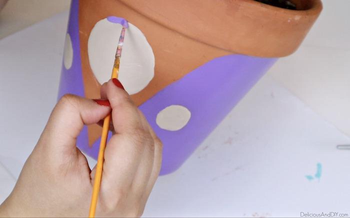 painting terracotta pot with purple paint