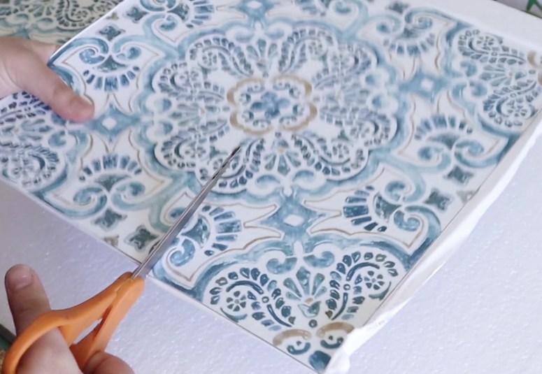 cutting removable floor pops tiles using scissors