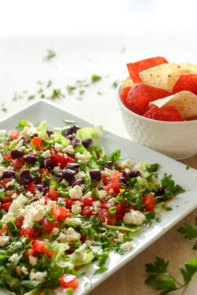 This Quick & Healthy Mediterranean Dip recipe is so fresh and delicious, so light feeling, that you won't be able to get enough. If you love hummus, feta and fresh crunchy vegetables, this dip makes a perfect lunch, snack, or addition to a holiday party table. So easy it's ready in just 10 minutes!