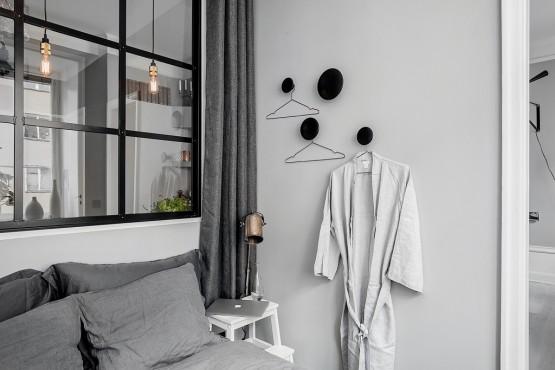 pisos pequeños distribución Piso pequeño con paredes grises paredes grises estilo nórdico estilo nórdico escandinavo diseño interiores pequeños decoración mini pisos decoración espacios pequeños decoración en gris y negro blog decoracion interiores