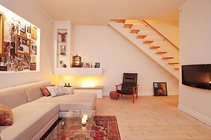 Un salón con chimenea de bioetanol decoración salones decoración pisos pequeños decoración dúplex chimeneas modernas chimenea sin tiro chimenea ecologica blog decoración nórdica
