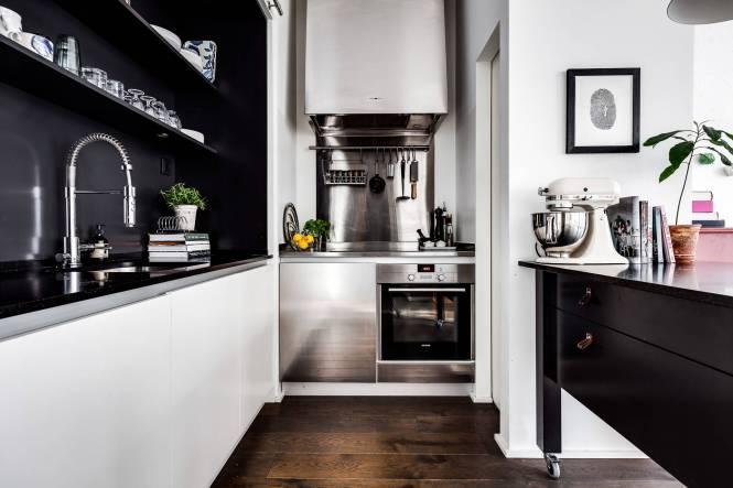 estilo escandinavo espacio diáfano cocina abierta Apartamento tipo loft