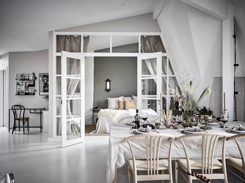 scandinavian penthaus pared de cristal estilo escandinavo distribución diáfana distribución abierta decoración blanca decoración áticos atico sueco