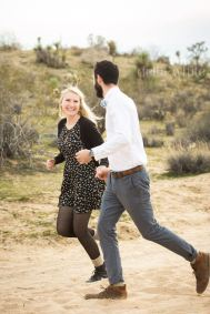 fun shot of a couple in the desert