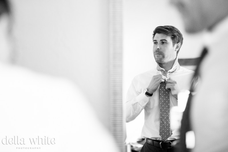 black and white mirror groom getting ready