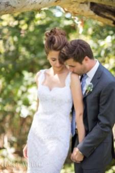 kissing the brides shoulder