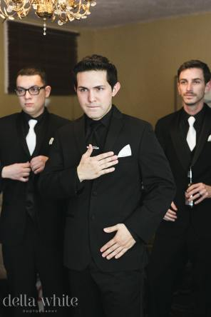 groom and groomsmen getting ready for the wedding day