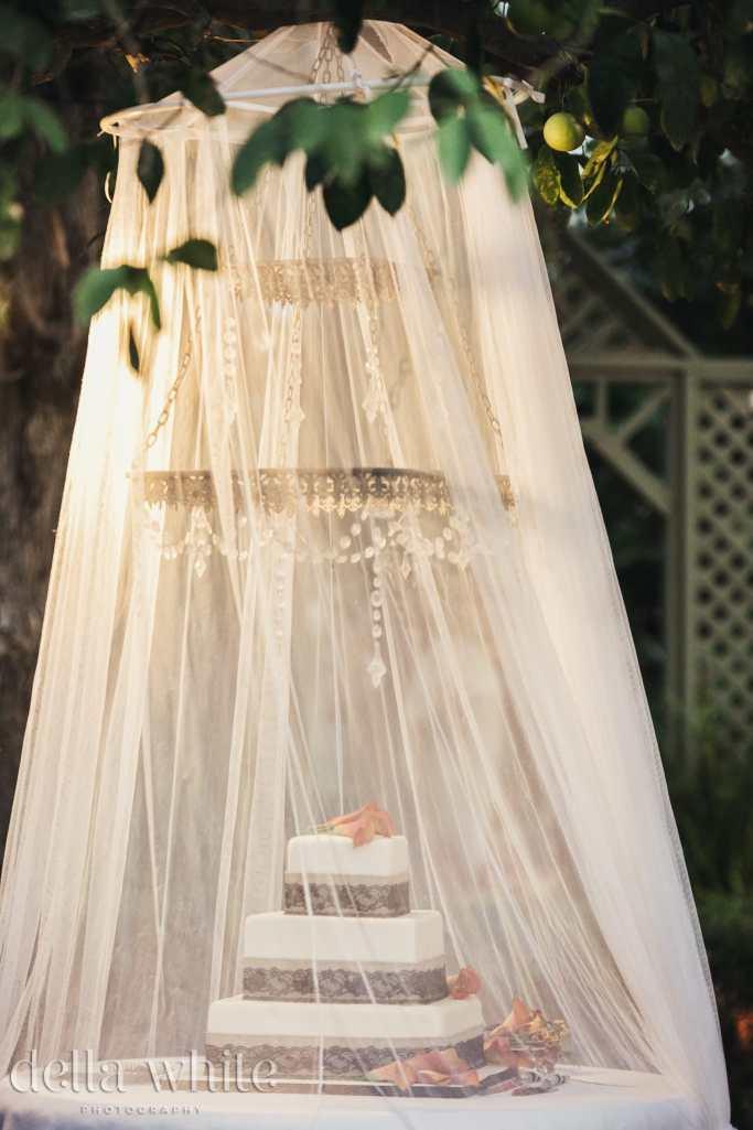 wedding cake with sheers draped around it