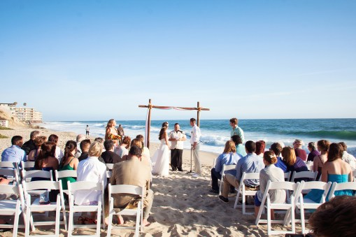 wedding ceremony on the sand in front of hotel laguna