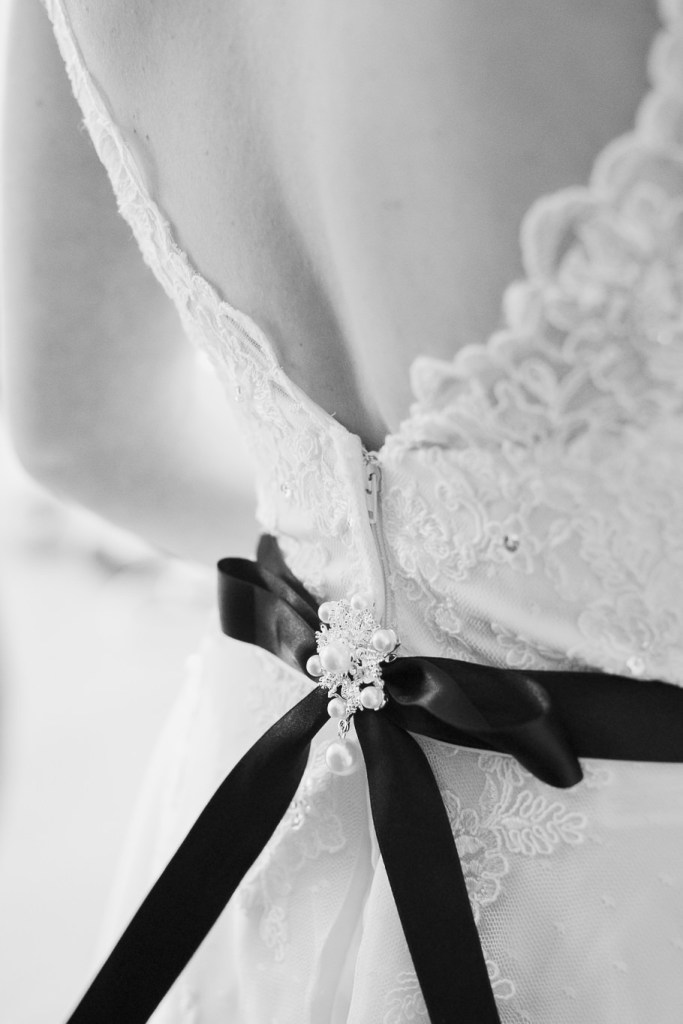 detail of the back of bride dress
