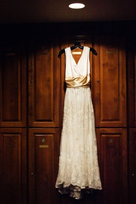 wedding dress hanging in locker room