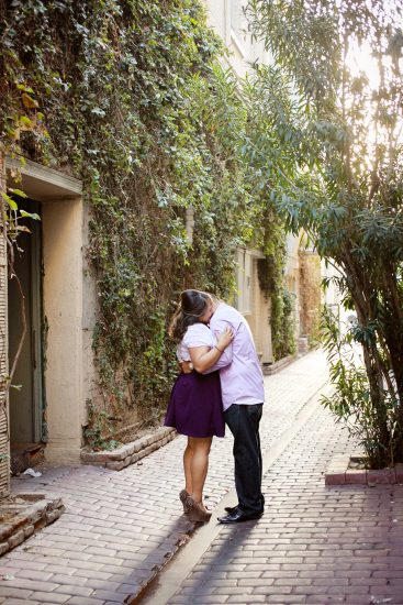 Riverside engagement photo in alley