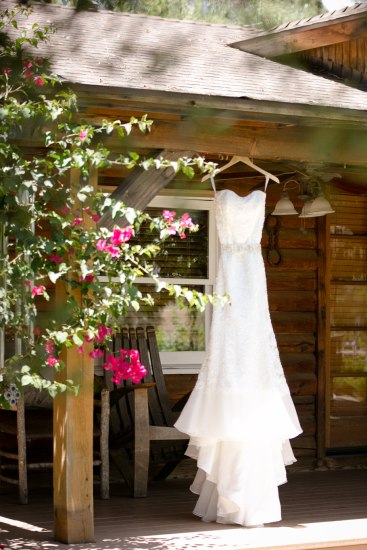 wedding dress hanging at lake oak meadows