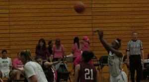 No. 22 Nyaa Davis launches a throw during the Feb. 12 game.